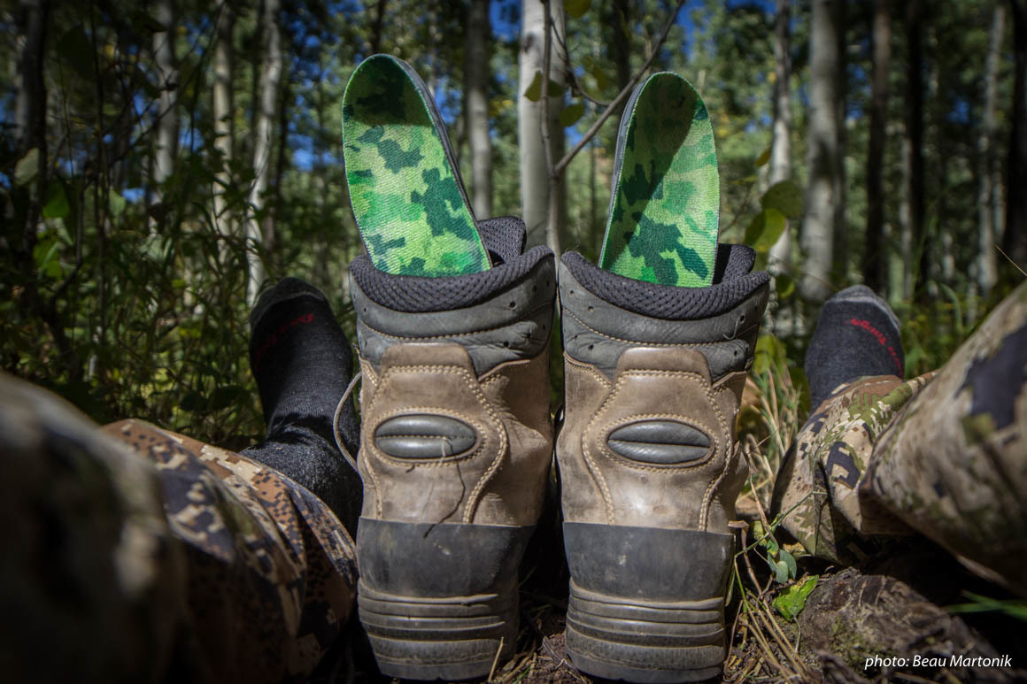 Hunting boots with insoles drying while hunting in the mountains.