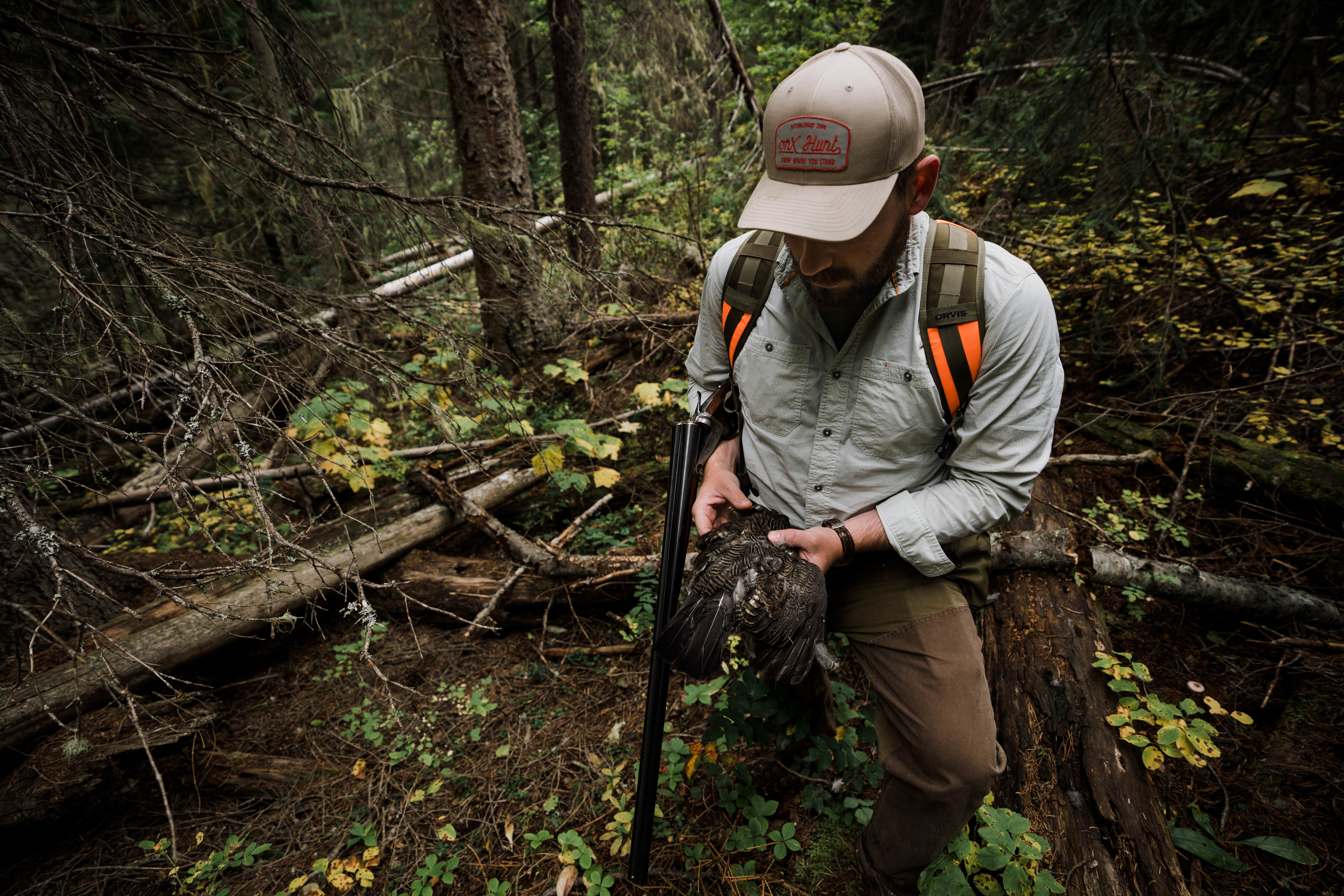 A hunter holds a spruce grouse harvested in northwest Montana.