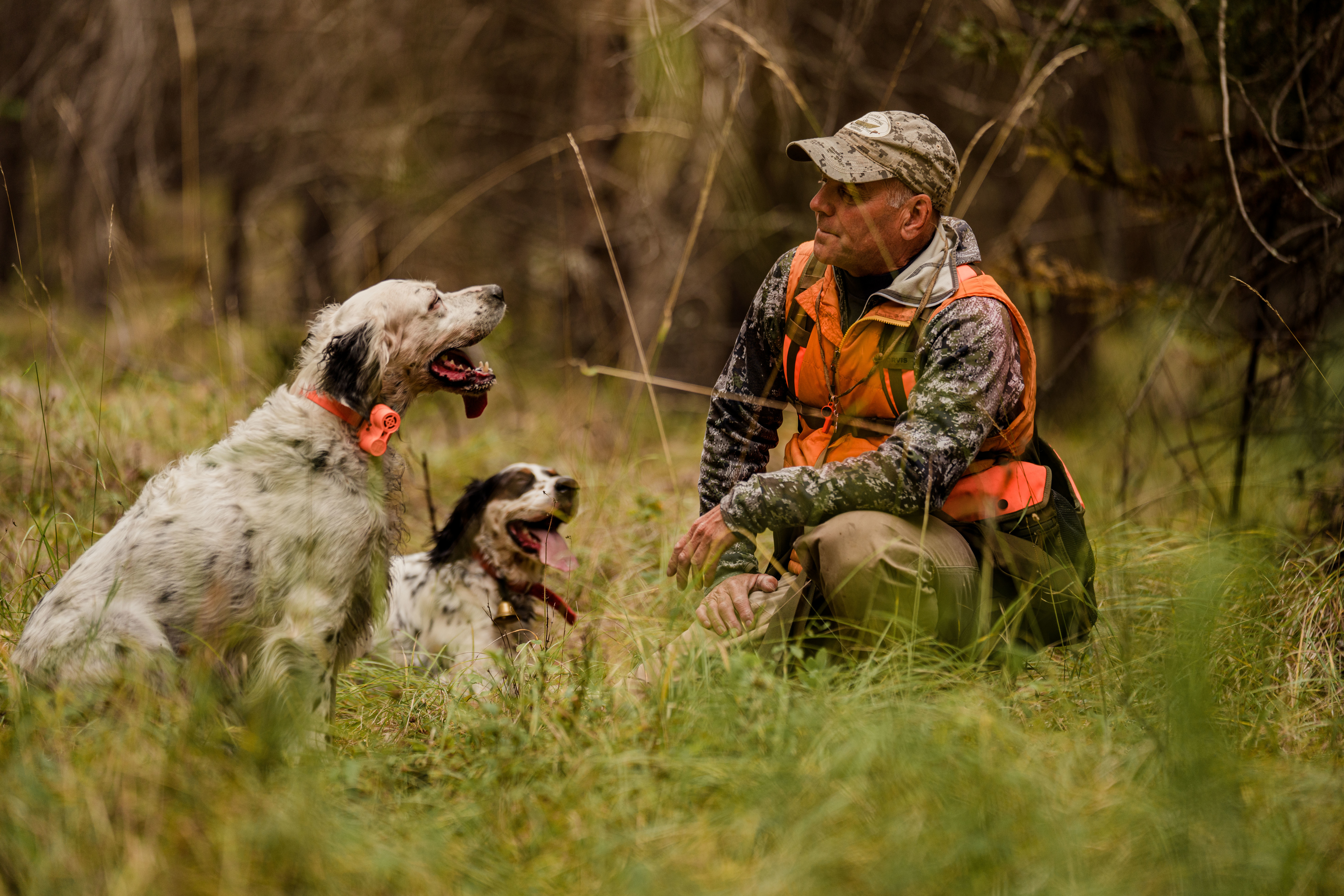 Montana outfitter Tim Linehan rests with his two setters.