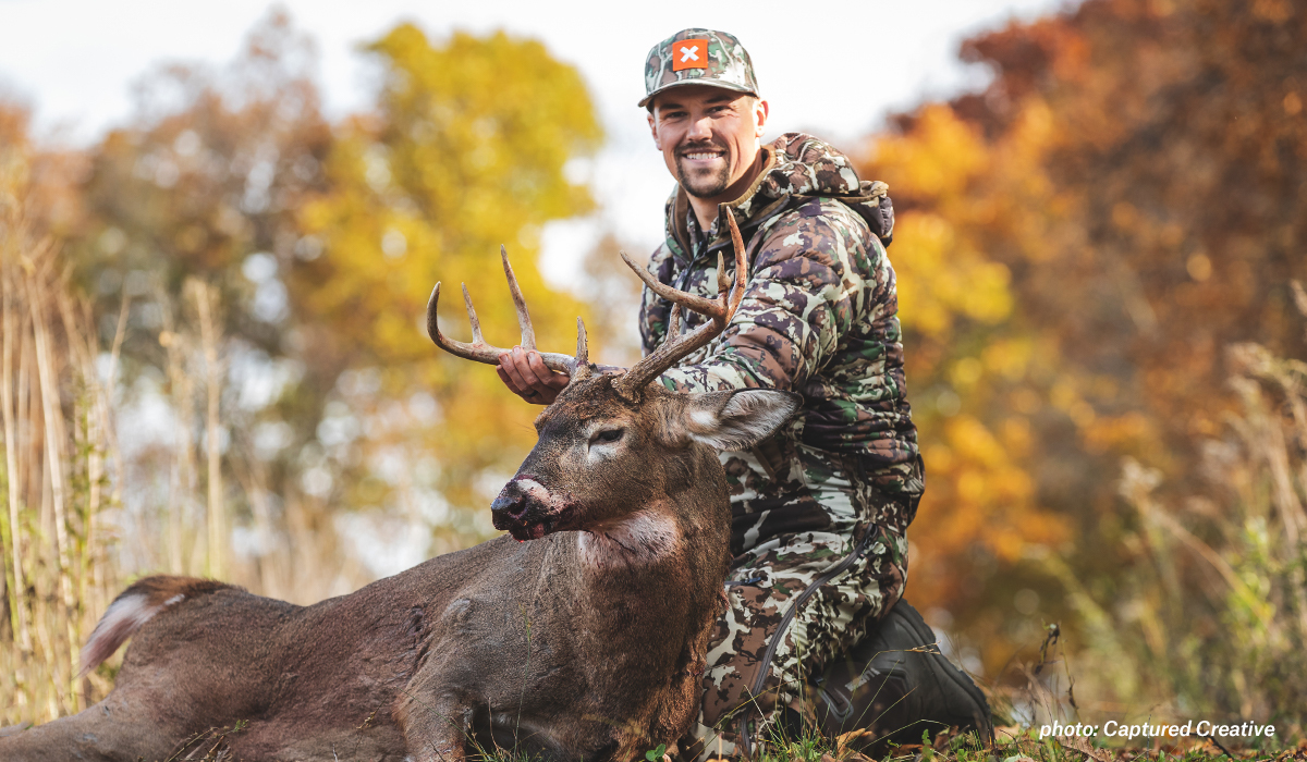 Mark Kenyon poses with a whitetail buck shot on MeatEater's Back 40 property.