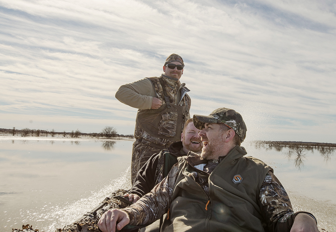 Wade Shoemaker and friends head into the swamp to go duck hunting in a boat.