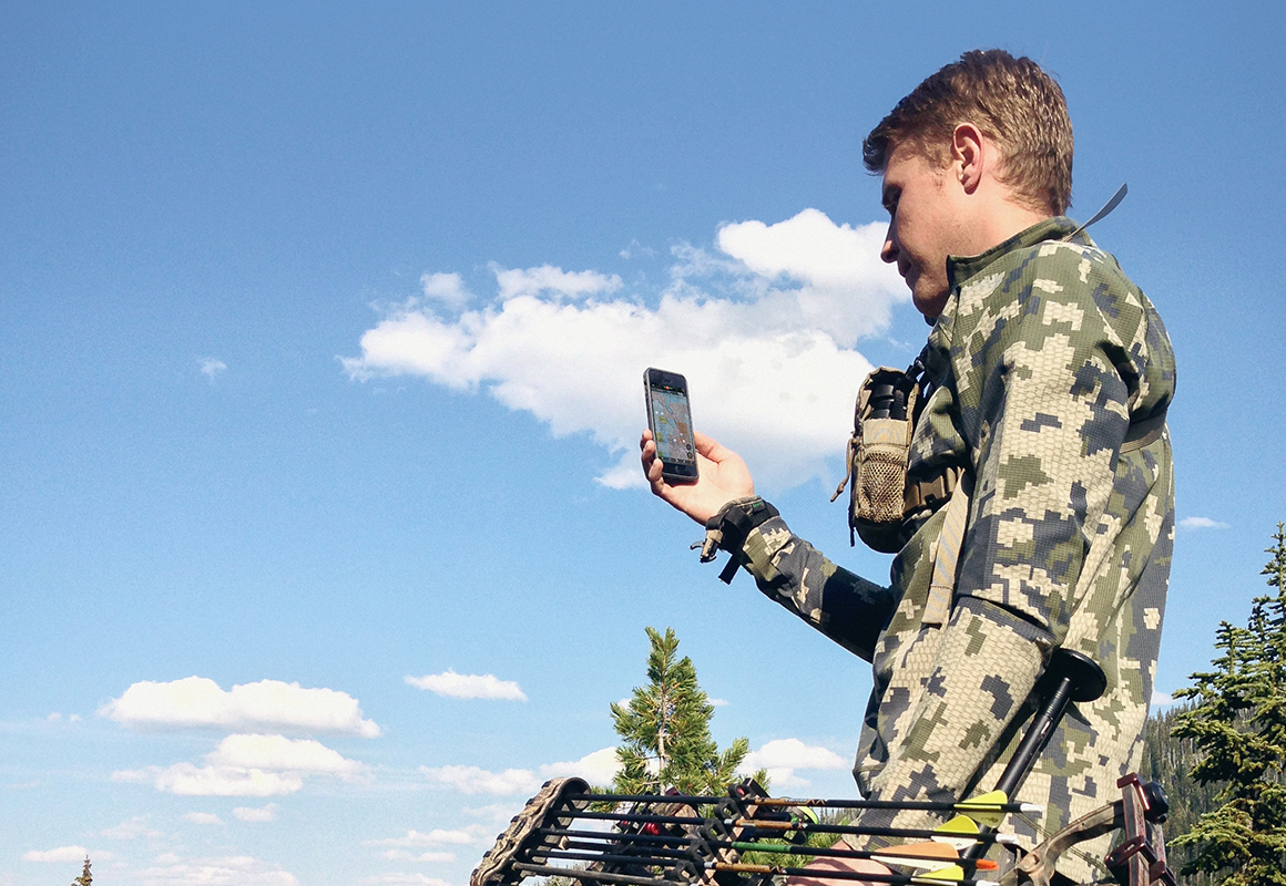 onX Hunt Founder Eric Siegfried bowhunting and using the onX Hunt GPS App on his phone.